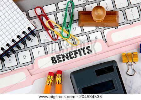 Benefits concept. Folder Register on Background of Computer Keyboard.