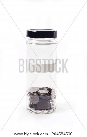 Coins in glass jar on white background for money saving financial concept