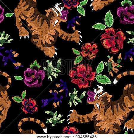 Embroidery oriental seamless pattern with tigers and roses. Vector embroidered floral patch for fabric and clothing design.