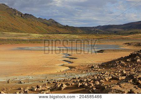 Steaming fumaroles in geothermal valley Hverir in Iceland
