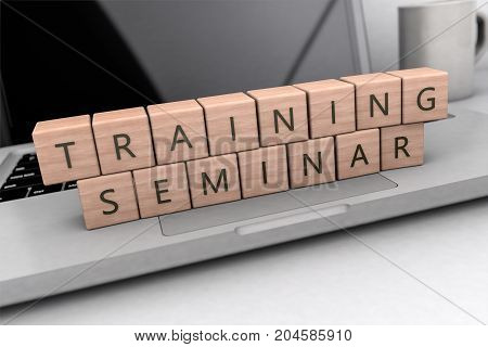 Training Seminar text concept, lettered wooden cubes on notebook computer- 3D render illustration.