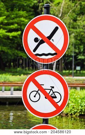No swimming and no bicycles road signs