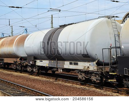 Oil transporter railway carriages in a row