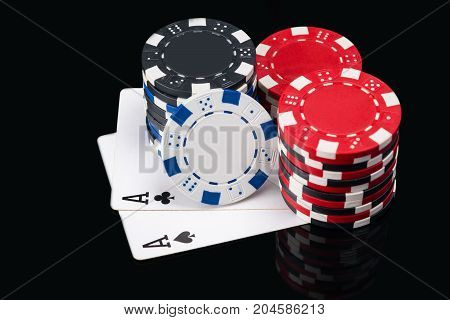 two large black cards to play poker under the poker chips