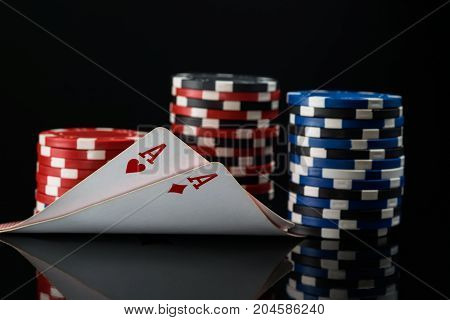 Two red aces in poker cards against the background of poker stakes