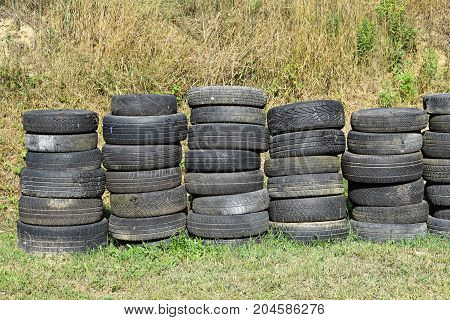 Old ruined car tires outdoor in summer