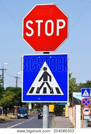Stop sign at the pedestrian crossing in the city