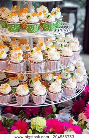 Wedding cupcakes tower stand with colorful flowers