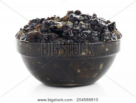 close up shot of traditional christmas mincemeat in glass bowl on a white isolated background