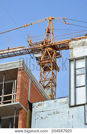Tower crane at the construction site in the city