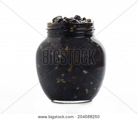 front view of a jar of traditional christmas mincemeat homemade with mixed fruits and brandy on a white isolated background