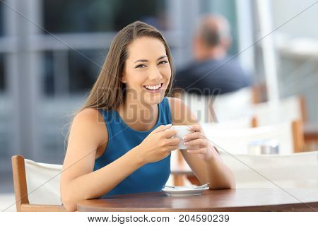 Woman Posing Looking At You In A Coffee Shop