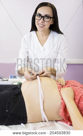 Young pregnant woman check up at doctors office