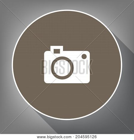 Digital camera sign. Vector. White icon on brown circle with white contour and long shadow at gray background. Like top view on postament.