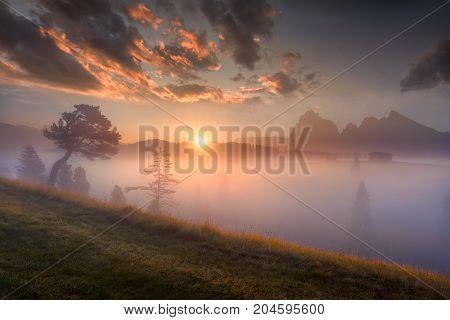 Mountain moody landscape at beautiful sunrise on Alpe di Siusi - Tyrol Italy.