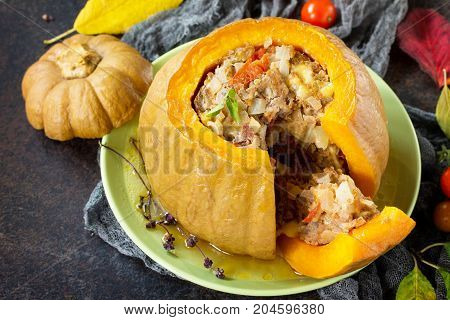 Baked Pumpkin Stuffed With Turkey, Tomatoes, Onions And Cheese. The Concept Of Food On Thanksgiving.