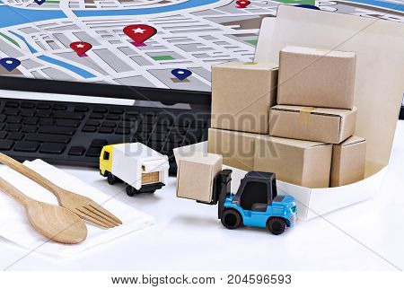 Food Delivery : Freight transportation or packages shipment in boxes and shipping logistics and business food Delivery concept.