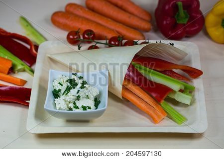 Vegetable sticks with fresh cheese for dipping