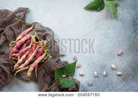 Green Bean Pod And Beans. Red Beans On A Gray Slate Or Stone Background. Top View With Copy Space.