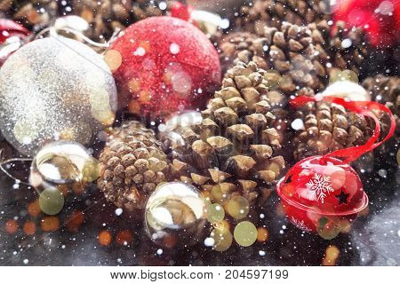 Christmas Background With Red Silver Balls And Pinecone.