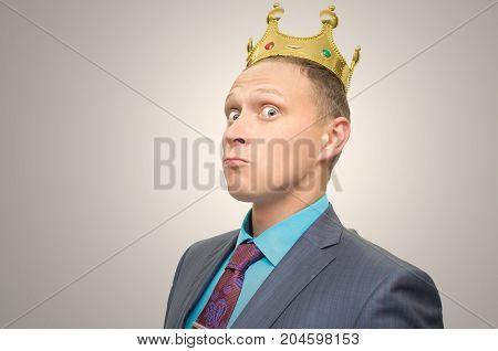 Smug boss. Pompous VIP client. Premium user concept. Success. Business man in suit with golden crown above head.