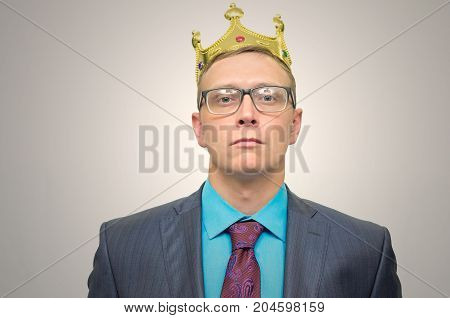 Smug boss. VIP client. Premium user concept. Success. Business man in suit with golden crown above head.