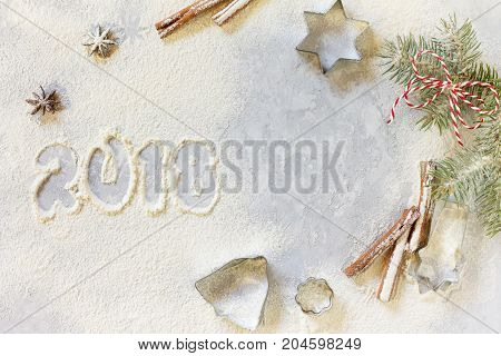 Ingredients For Christmas Baking - Spices, Powdered Sugar And Cookie Shapes On A Stone Background. S