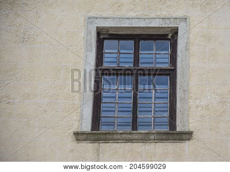 Old window in the city in summer day