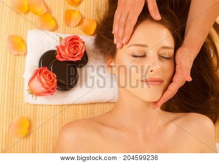 Face Massage. Close-up Of A Young Woman Getting Spa Treatment