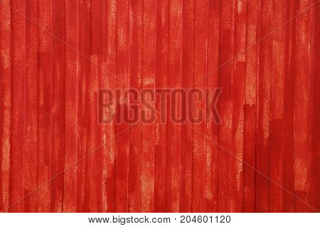 Red Painted Uneven Metal Wall Surface Close Up