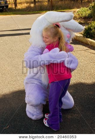 Young girl cuddling Easter bunny