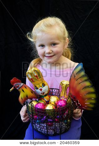 Pretty young blonde girl with Easter eggs