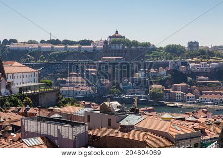 Aerial View Of Dom Luis I Bridge Over Douro River And Oporto's Houses, Portugal