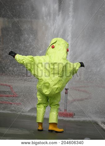 Person with yellow protective suit with air filtering system to breathe during a fire or during a bacteriological attack