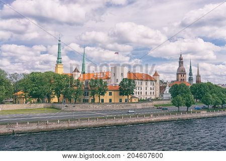 Panorama of the Latvian capital Riga with the spire of the cathedral and the presidential palace in a summer day with ships