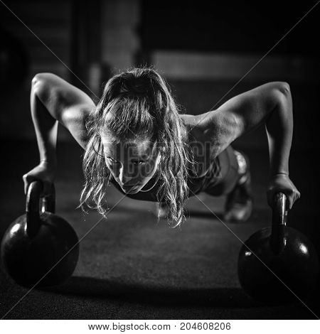 Woman Athlete Exercising With Kettlebell, Black And White Image, Black Background