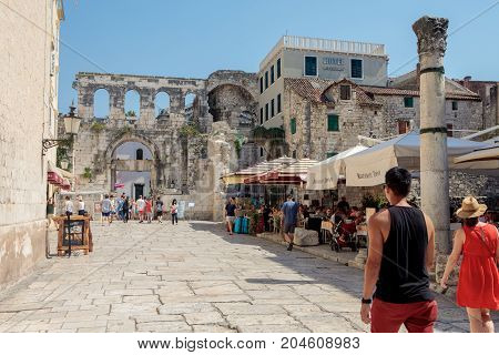 Split Croatia - August 19 2017: Tourists walk and look at remains of Diocletian's palace in Split.