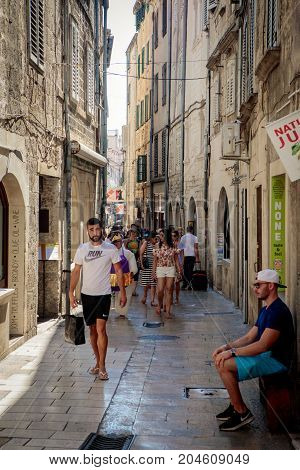 Split Croatia - August 19 2017: Tourists walk in the narrow streets of ancient roman city Split.