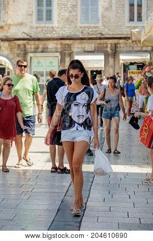 Split Croatia - August 19 2017: Unidentified girl walks on the street of old town of Split.