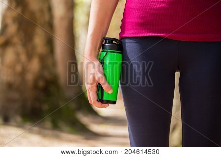 Fitness Girl, Race In Nature, Shaker, Flashes For Protein In Hand, Along Well-built Legs