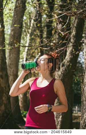 Fitness Girl, Race In Nature, Shaker, Flask For Protein In Her Hand, Drinks From The Flashes, Takes