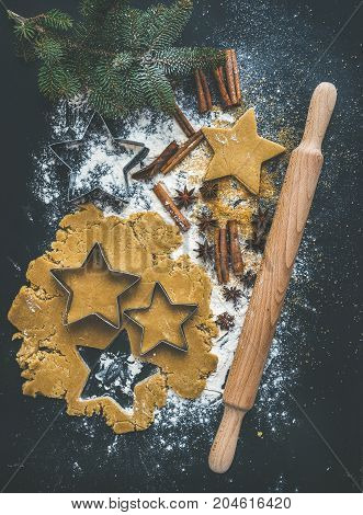 Baking ingredients for Christmas holiday traditional gingerbread cookies preparation, black background, top view