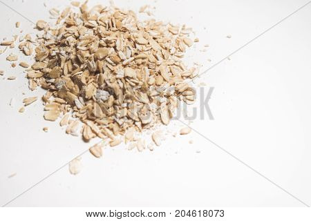 Grains of oatmeal porridge, cereal on white background top view