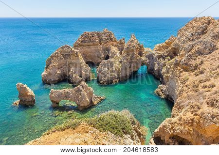 Rocks in blue sea at portuguese coast
