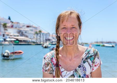 Woman as tourist in harbor of Portugal