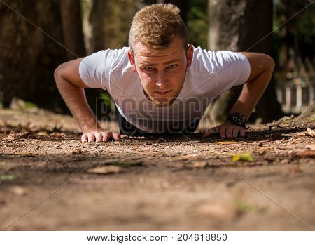 Athlete is wrung out sport push-up athletic man athletic