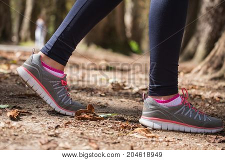 Close Up Of An Athlete's Feet Wearing Sports Shoes On A Challenging Dirt Track. Trail Running Workou