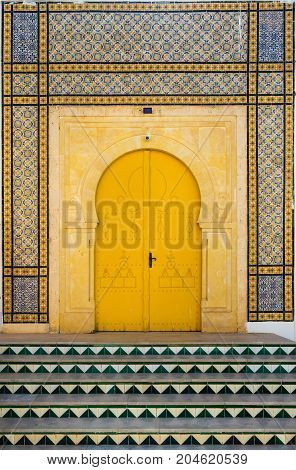 Traditional Tunisian Door With Tiles And Ornament As Symbol