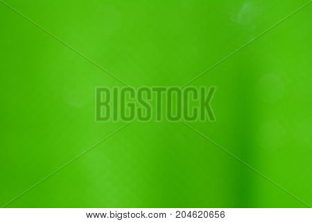 The Green Color With White Hexagon Blurred  Background
