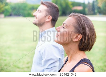 Couple Of Man And Woman Breathing Deep Fresh Air Together In The Nature
